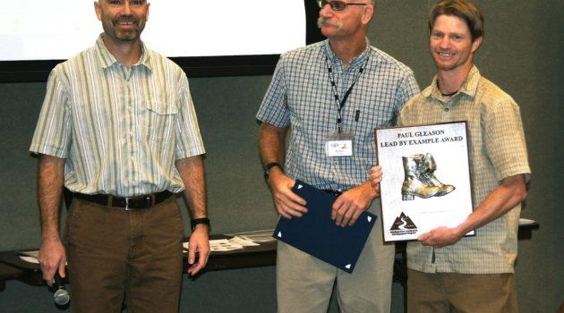 Travis receiving the Paul Gleason 'Lead by Example' Award