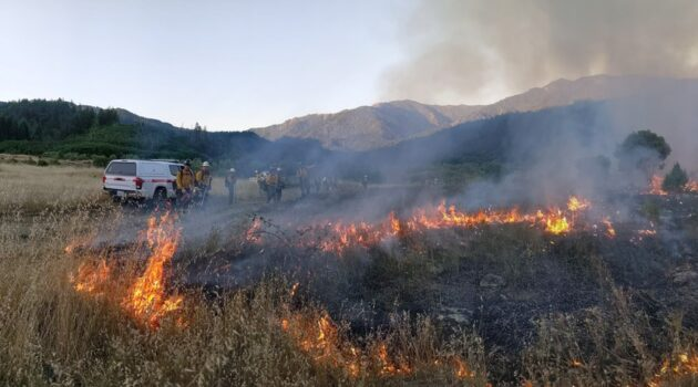 A fire burns in Tishawnik with smoke rising
