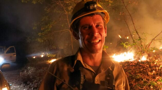 Will smiling in foreground while managing a prescribed fire.