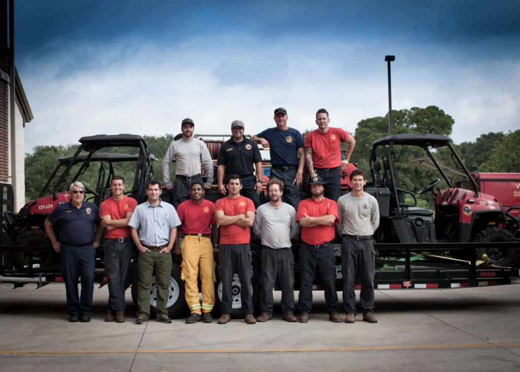 Group stands in front of fire fighting equipement