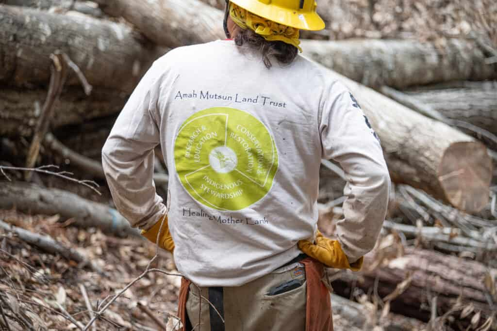 Man in foreground with t-shirt of the AMLT mission statement
